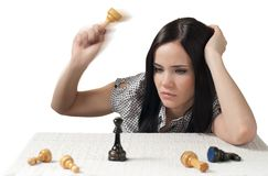 Thinking girl with chess. She looking for decision Royalty Free Stock Photo