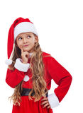 Thinking girl in christmas outfit Stock Photography
