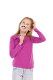 Thinking girl with a fake mustache Stock Photo
