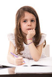 Thinking girl in kindergarten Stock Photo