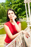 Thinking girl in park Royalty Free Stock Photography