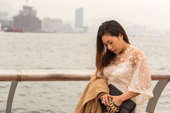 Thinking Girl on a Pier. In Hong Kong Island Stock Photo
