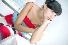 Thinking girl sitting Stock Image