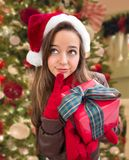 Thinking Girl Wearing A Christmas Santa Hat with Bow Wrapped Gif Stock Photos