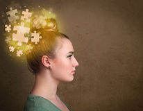 Thinking with glowing puzzle mind on grungy background Stock Photo