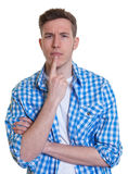 Thinking guy in a checked shirt Stock Photography