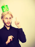 Thinking guy with green gift box on his head Royalty Free Stock Photos