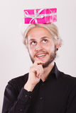 Thinking guy with pink gift box on his head Stock Images