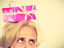 Thinking guy with pink gift box on his head Royalty Free Stock Photos