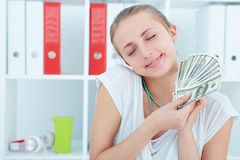 Happy woman holding dollars in hands and want to spend money. Thinking happy woman holding dollars in hands and want to spend money Stock Photos