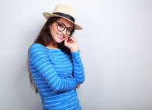 Thinking happy young woman in hat and glasses looking with smili Stock Photo