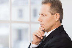 Thinking about his business. Royalty Free Stock Images