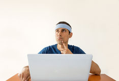 Thinking  his next bet online Royalty Free Stock Photos