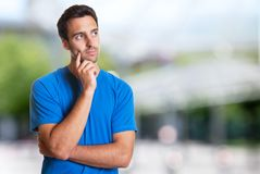 Thinking hispanic man with beard. Outdoor in the summer Royalty Free Stock Image
