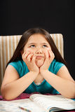 Thinking about Homework. Young girl thinking about her homework Stock Photo