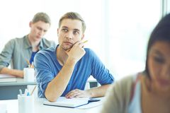 Thinking of idea. Clever student thinking of idea of essay Stock Photography