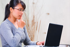 Thinking if front of laptop Stock Image