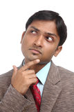 Thinking Indian businessman Stock Photography
