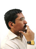 Thinking. Indian man with deep thought Royalty Free Stock Photos