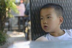 Thinking kid Stock Image
