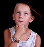 Thinking kid studio shot. Stock Photo