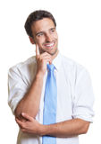 Thinking latin businessman with blue tie Royalty Free Stock Image