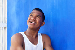 Thinking latin guy in front of a blue wall Stock Photos