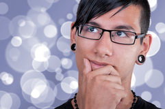 Thinking latino boy Stock Image