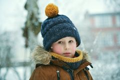 Thinking little boy at winter royalty free stock photography