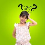 Thinking little girl Stock Photo