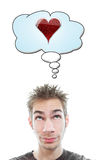 Thinking about Love. Young adult white Caucasian man thinks about love in his think bubble above his head isolated on white background Stock Photo