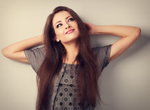 Thinking make-up beautiful female model relax near the wall. Vin Royalty Free Stock Images