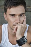 Thinking Man. The portrait of young handsome man. He is thinking about something Royalty Free Stock Photos