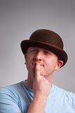 Thinking man in bowler hat Stock Photography
