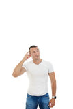 Thinking man in casuals looking up in blank copy space Stock Photography
