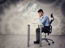 Thinking man front of laptop Stock Photos
