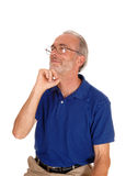 Thinking man with hand on chin. Royalty Free Stock Photo