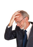 Thinking man with hand on head. Stock Photography
