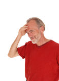 Thinking man with hand on head. Stock Images