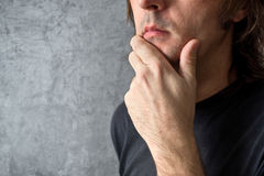 Thinking man with hand on his chin Royalty Free Stock Photos
