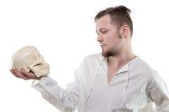 Thinking man with human skull Stock Photos