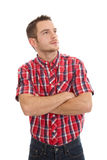 Thinking man isolated on white. Thinking man in a red plaid shirt Royalty Free Stock Photos