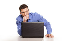 Thinking man and laptop. Attractive businessman With Laptop, On White Background Stock Photography