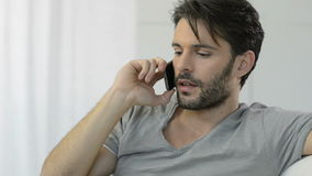 Thinking man at mobile phone stock footage