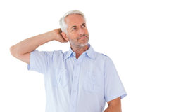 Thinking man posing with hand behind head Stock Photography