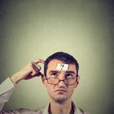 Thinking man with question mark Royalty Free Stock Image