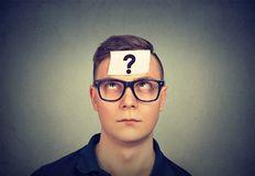 Thinking man with question mark royalty free stock photo