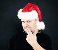 Thinking Man in Santa Hat Royalty Free Stock Images