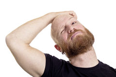 Thinking man scratching his head Stock Image