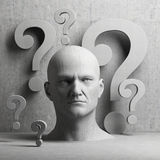 Thinking man statue and question marks Stock Image